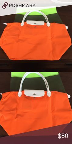 Brand new longchamp medium pliage tote Orange, medium sized tote, with white leather detailing. This was a limited edition style. Longchamp Bags Shoulder Bags