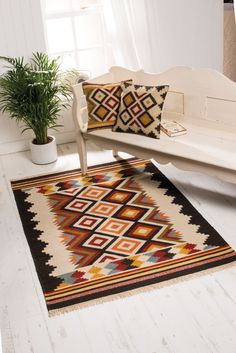 This beauty full kilim rug in earthy tones and simple geometric design will compliment any room setting from traditional to modern. There are also matching cushions available to match. Simple Geometric Designs, Sofa Throw, Carpet Design, White Rug, Kilim Rugs, Rugs On Carpet, Home Furnishings, Decoration, Cushions