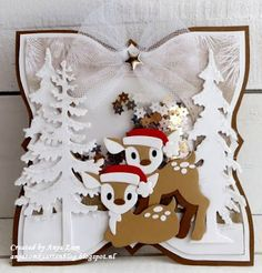 Handmade card by DT member Anja with Collectables Eline's Deer (COL1401), Eline's Polar Bear for the hat (COL1370), Creatables Spar (LR0378) and Den (LR0379) from Marianne Design