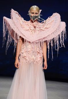 What is on her face?  What the heck is she wearing? ~~ Amato Haute Couture Spring/Summer 2012