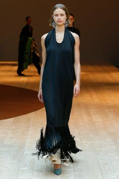 Céline F/W 2017. This is such a curious and lovely neck shape to me, a very soft deep u that's not very crisp at all, just feels like the fabric's been pinned around behind the neck. And the dress fringes and the pant ties are fluttering about madly at the hem.