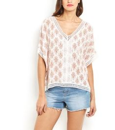 Lightweight and loose fit, this White Paisley Print Crochet Trim Top is the stylish way to keep cool in summer. #newlook #fashion