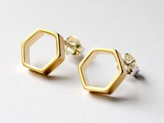 Geometric Gold Hexagon Stud Earrings - Simple Small Hexagonal Gold Earring Studs - Honeycomb and Bees by HookAndMatter on Etsy https://www.etsy.com/listing/157524106/geometric-gold-hexagon-stud-earrings