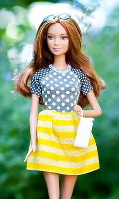 This Barbie Fashionista is not afraid to mix prints!  She creates a fun and unique style fit for an afternoon trip to the art museum. [ad] ==
