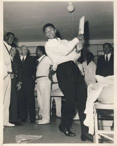 Cricket - World Famous boxer, Mohammad Ali takes a stroke st Lord's Cricket Ground in 1966.