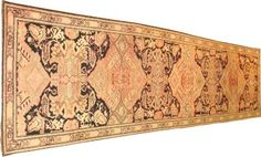 Unusual, very long antique Russian runner, terra-cotta and black