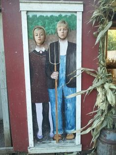 American Gothic head in hole at Fall Harvest Orchard, Delano MN. There are so many possibilities for using famous paintings as photo ops.