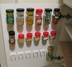 Organize Your Kitchen (On a Budget!) • Great inexpensive kitchen organizing ideas, including this idea using mop handle clips to store spices from 'Barry and Christie'!