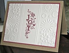 handmade Christmas card ... clean and simple design ... luv the way the embossing folder design is placed on the two sides with embossed lines separating the flat section with the stamping ...