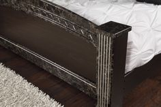 The poster bed has luxurious faux-marble posts