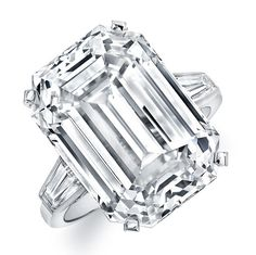 Classic Ring 1 - 3 stone ring with white radiant diamond center stone and tapered baguette sidestones in 18kt white gold.