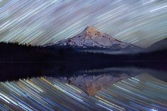 Ben Canales - Colorful Star Trails Reflected in a Lake Beautiful. For avid Photographers - How to photograph the night sky. Give that video a look, find a still lake on a clear night, and you can make one of these photographs yourself! Time Lapse Photography, Star Photography, Photoshop Photography, Night Photography, Photography Tutorials, Photography Ideas, Landscape Photography, Starry Night Sky, Night Skies