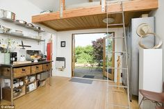 This property is bright and airy, with a ladder leading up to a bed big enough for three