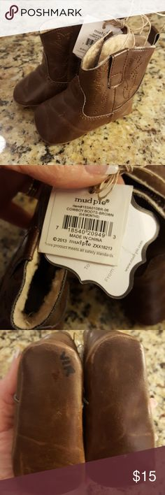 Mud pie Cowboy Boots mudpie Mud pie Cowboy Boots, size 0 to 6 months, Velcro opening. Love a great bundle deal only 1 shipping cost 😊. All offers are considered and most are accepted. Happy Poshing!! Mud Pie Shoes Boots