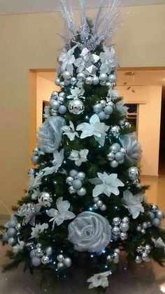 This is a very unique Tree! Very different. The decorations are nothing like I have ever seen. White roses and silver bulbs for a Christmas tree is a beautiful idea. #christmasdecor #ChristmasTreeIdeas #worldkindnessday