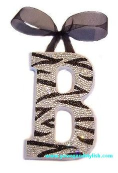 Decorate your own letter. Buy a wooden or plastic letter from any store (walmart, home depot, sears, etc) then get rhinestones, jewels, paint, sparkles, and ribbon to decorate it with!