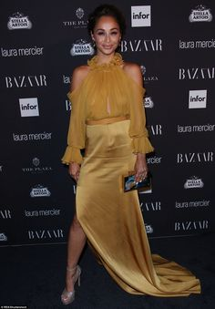 Amazing lady: Cara Santana chose a gold frock with equally sparkling heels for an incredible look