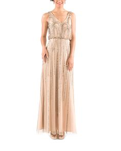 DescriptionAdrianna Papell Sleeveless Bloson Gown with Art Nouveau Beading in Taupe PinkFulllength bridesmaid dressVnecklineNaturalwaistBeaded meshNeed it faster? Ask your stylist about in-stock availability!