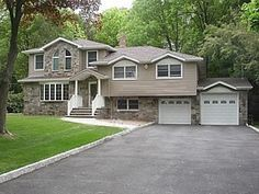 Craftsman bi level in haworth exterior home styles for Additions to split level homes