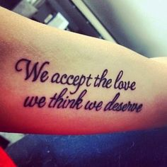 We accept the love we think we deserve writing tattoo on arm