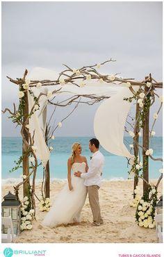 Rustic driftwood style beach wedding arch in The Caribbean -dream archway!