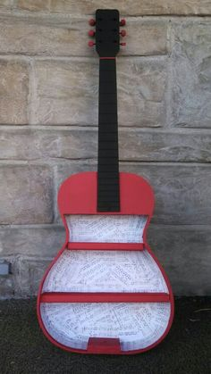 Throw away a broken guitar?!? Never! Give it a new purpose!