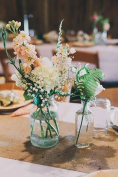 Rustic Centerpieces - burlap and jars of flowers- for long tables!