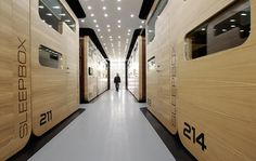 A visitor walks past individual sleeping quarters in Moscow's first micro hostel