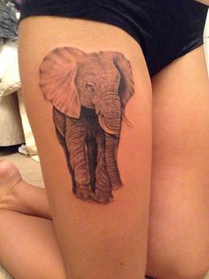 This elephant tattoo but have him holding lilies with his trunk. And different placement.