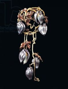René Lalique. 1902 'Clematis' Brooch. Gold, oxidized silver, white, and brown enamel. Private collection