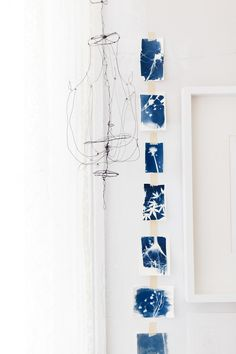 """This chandelier came about after studying [Alexander Calder's] work and a couple late-night espressos. The blue and white pieces of artwork are part of a collection of cyanotypes I did with my daughters this summer."" —Emily Jeffords, local artist in Greenville, SC. Feature by Design Sponge. // yeahTHATgreenville"