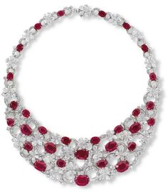 Ruby & Diamond 'Flora' Necklace, by Bvlgari, features thirty oval-shaped rubies weighing approximately 7.00 to 1.21 carats each, connected by keystone and whistle-cut diamonds set in a 18K white and gold setting.