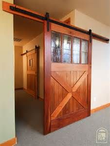 Image result for hang barn door from ceiling