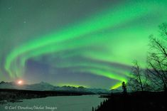 Aurora borealis, moon and Denali, Denali State Park, Alaska.