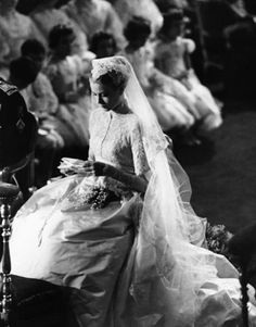 Grace Kelly is a picture of a demure bride, at her wedding to Prince Rainier, in the Monaco Cathedral, on April 19, 1956.