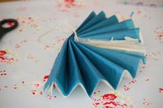 Well, here it is - a tutorial on how to make a tissue paper flower (with tulle). Good luck and please feel free to ask any questions in th...