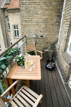 Simple wood furniture makes this small balcony comfortable yet roomy.