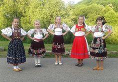 Vígľaš village, Podpoľanie region, Central Slovakia.  Girl in red wears stylizated version of regional folk costume, probably from some folk ensemble.