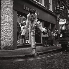 24th January 1967: Cat Stevens (later Yusuf Islam) leaps a bollard.