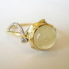 Gold ring with a prehnite and diamond. www.heleenhoogenboom.com