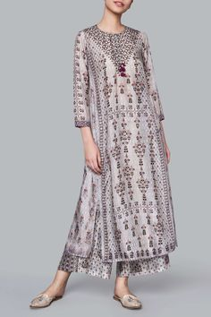 Anita Dongre Featuring a grey long kurta in modal satin base with block printing and motifs of lush flora from the Ranthambore. It boasts of round keyhole neckline with tassel detailing.Buy Ranthambore jungle print tunic by Anita Dongre at Aza Fashio Kurti Neck Designs, Kurta Designs Women, Pakistani Fashion Casual, Indian Fashion, Pakistani Suits, Womens Fashion, Indian Gowns, Indian Attire, Indian Wedding Outfits