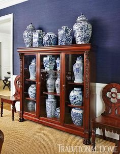 Blue-and-White China: A collection of blue-and-white vases are displayed in a wooden cabinet, carrying the home's repeating palette into the dining room. Blue White Decor, Navy And White, Ginger Jars, White Pottery, Blue And White Vase, Blue China, Blue And White, Blue Decor, Home Decor