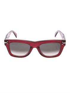 For the most fashion-forward sunglasses we turn to Parisian label Céline. This square-shaped design is crafted from red transparent acetate and features thick frames and graduating green lenses.