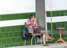 Bathroom cleaning employee: Senior woman sitting outside a public toilet on a chair to collect donations. She keeps the toilet clean and patrons give her some money. A way of self employment. Cuba has two million people who are 60 and over, and by 2030 that number will be around 3.3 million. Cubas ageing population is widely-acknowledged as a serious problem.