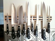 knife magnet. Want one so bad! Storing my interchangeable blades for my kitchen knife would be waaaay better this way.