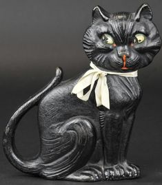 """SITTING CAT DOORSTOP """"Copyright 1927 A.M. Greenblatt Studio, 20,"""" wedge back design, features black shifty-eyed cat with curiously posed tail, whimsical & fun doorstop. 9"""" h. (Near Mint Cond.)"""