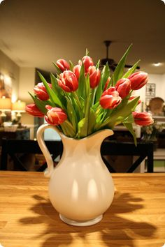 White pitcher with flowers - centerpiece