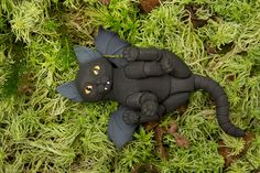 """This is a BJD Cat Vampire. He has 4 changed heads, """"Bat"""" wings and """"Log"""" tail.  ____________________  Mold: Kitten Size: 6,5 cm Color: Black, Gradient: - Airbrushing: Gray (inner of the ears and wings) Head options - Ears: Standard Mouth: Vampire Eyes: Narrowed (yellow oval). Tail: Long Wings: Bat"""