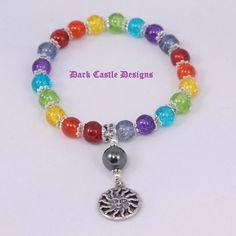 Chakra Coloured Beaded Bracelet with Sun by darkcastledesigns