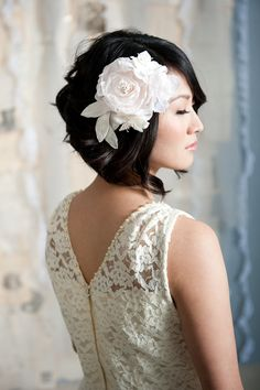 I'm indecisive hairwise. Keep it almost-long and do an updo with my silk flower? Or this adorable cut nicely styled with said flower?